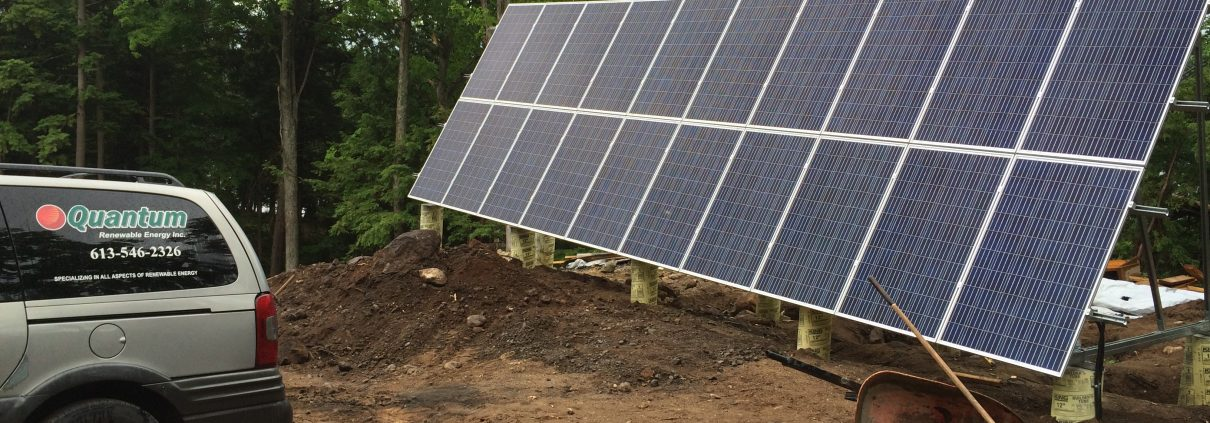 Solar panels installed; Quantum Energy van in picture