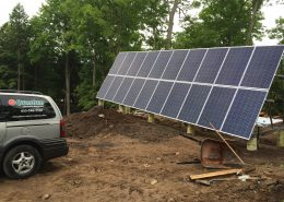 Solar panels installed; Quantum Energy van in picture
